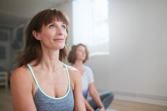 Yoga trainer during workout session in gym Stock Photography