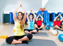 Yoga training exercise in fitness gym people group Stock Photo