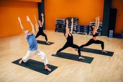 Yoga training, female group with male instructor Stock Image