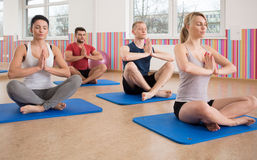 Yoga training on foam mattress Royalty Free Stock Images