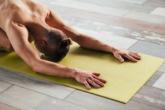 Yoga training sport wellness lifestyle gym workout. Yoga training. sport and fitness. wellness lifestyle and regular gym workout. man exercising on a mat royalty free stock photo
