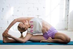 Yoga training in sunny loft Stock Image