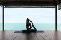 Yoga Training. Woman In Sport Clothes Stretching Body Near Sea stock photography