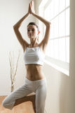 Yoga tree pose. Young woman doing yoga, tree pose Royalty Free Stock Photo