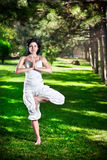 Yoga tree pose in park Stock Photo