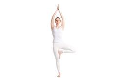 Yoga Tree pose Stock Photo
