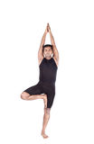 Yoga tree pose on white Royalty Free Stock Photo