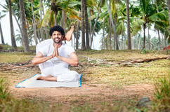 Yoga in tropical India Royalty Free Stock Photos
