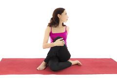 Yoga twist. Woman doing a yoga twist for stretching (Series with the same model available Stock Photo