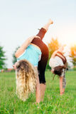 Yoga. Two young women doing yoga exercise Royalty Free Stock Images