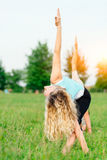 Yoga. Two young women doing yoga exercise Stock Photos