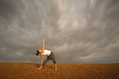Yoga under cloudy sky Royalty Free Stock Photography