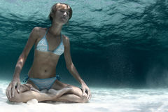 Yoga underwater Stock Images