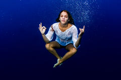 Yoga underwater. Woman doing yoga underwater in lotus pose Royalty Free Stock Image