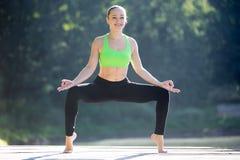 Yoga utkata konasana pose royalty free stock images