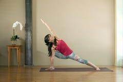 Yoga Utthita Parsvakonasana. Woman in her 40's practicing the yoga pose Side Angle; Utthita Parsvakonasana Royalty Free Stock Photos