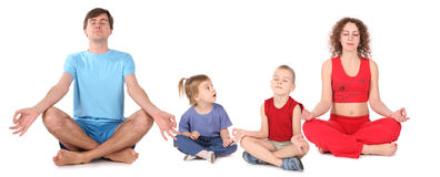 Yoga-vierköpfige Familie Lizenzfreie Stockfotografie
