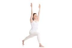 Yoga Virabhadra 1 Pose. Sporty beautiful young woman in white sportswear doing high lunge exercise, Warrior I posture, Virabhadrasana 1, studio shot, isolated royalty free stock image