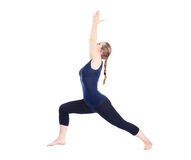 Yoga virabhadrasana I warrior pose Stock Photo