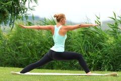 Free Yoga Virabhadrasana II Warrior Pose Royalty Free Stock Photo - 46768615
