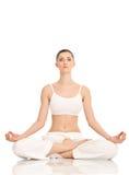 Yoga, vrouw in lotusbloempositie Royalty-vrije Stock Foto