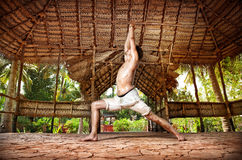 Yoga warrior in Indian shala Royalty Free Stock Photo
