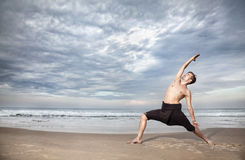 Yoga warrior pose in India Stock Photo