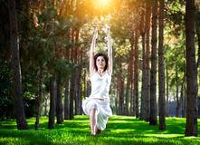 Yoga warrior pose in park Stock Photos