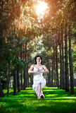 Yoga warrior pose in park Royalty Free Stock Photography