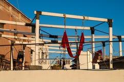 Yoga and wetsuit on balcony.  Royalty Free Stock Photo