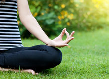 Yoga woman. On green grass Stock Photos
