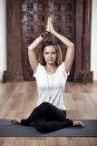 Yoga woman in asana pose. Woman Yoga practitioner in gomukhasana cow face pose Royalty Free Stock Photo