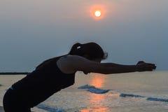 Yoga woman on the beach Stock Photo