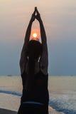 Yoga woman on the beach Stock Photos
