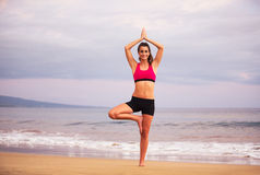 Yoga Woman on the Beach At Sunset Royalty Free Stock Photos