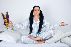 Yoga woman in bed Royalty Free Stock Photo