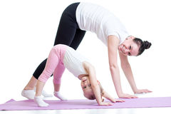Yoga for woman and child. Mother and kid do Stock Image