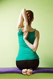 Yoga woman clutches hands behind back Royalty Free Stock Image