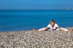 Yoga woman doing exercises Stock Photography