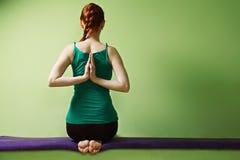 Yoga woman folding palms behind back Stock Images