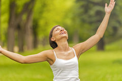 Yoga woman on green gras Royalty Free Stock Photo