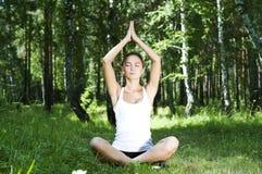 Yoga woman on green grass Stock Photos