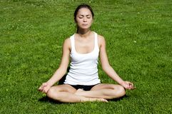 Yoga woman on green grass Stock Photo