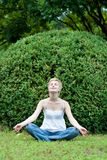 Yoga woman on green grass Royalty Free Stock Photography