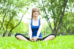 Yoga woman on green grass Royalty Free Stock Images