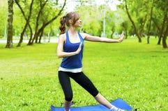 Yoga woman on green grass Stock Photography