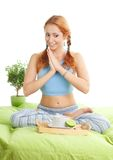 Yoga woman having a tea. Yoga woman about to having a tea in bed and anticipate taste and rubbing a hands royalty free stock photos
