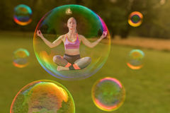 A yoga woman is hovering. In a soap bubble Stock Images