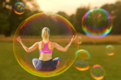 A yoga woman is hovering. In a soap bubble Stock Photography