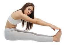 Yoga woman. Image of asian young woman performing yoga on white background Stock Images